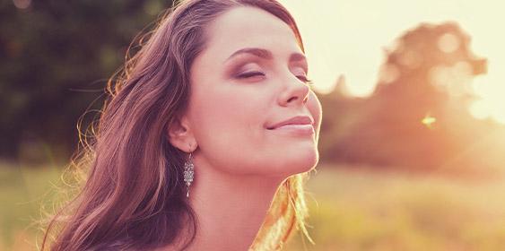 Woman enjoying the sun light by Reflection Aesthetic Center